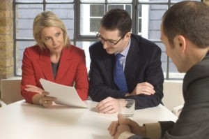 legal nurse consultant and attorney looking at legal nurse consultant's writing skills