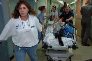 medical team pulling a stretcher