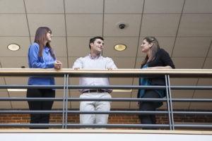 people talking inside a company