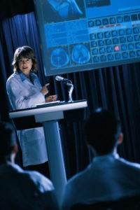 nurse at podium making a presentation for attorneys
