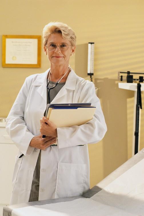 nurse holding medical records