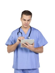 male completing medical record