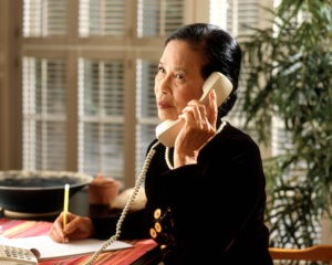 Woman listening to angry attorney on the phone