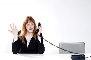 annoyed woman talking to dreamstealer on phone