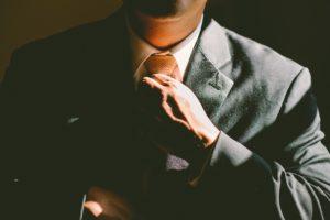decisive attorney straightening his tie