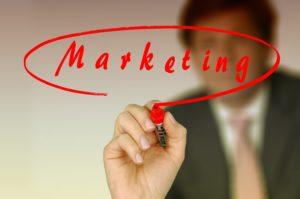 businessman writing marketing