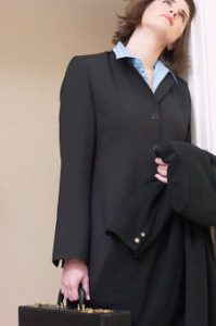 woman in business suit thinking of the myths of legal nurse consulting
