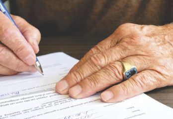 signing a contract and check shows commitment principle