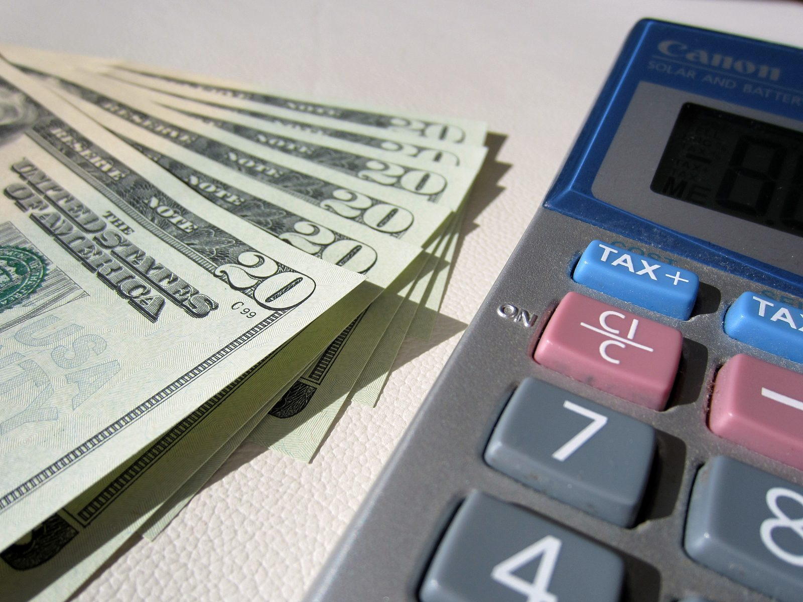dollars and a calculator - why it is important in keeping track of expenses
