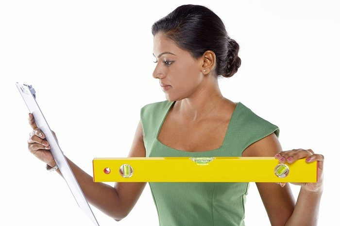 Businesswoman using a measuring device