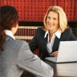image of attorney and legal nurse consutlant by a computer