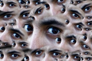 face surrounded by eyes in 5 types of fears