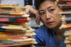 man looking at medical records