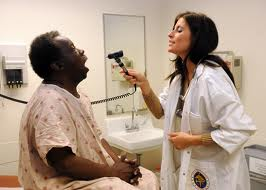 nurse practitioner examines patient