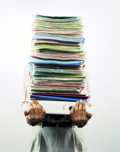 person carrying stack of medical records