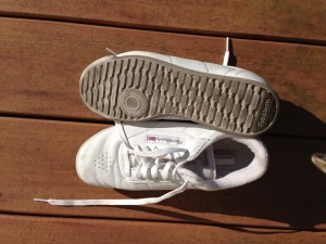 Previously white shoes I used when I walked around the house before cleaning.