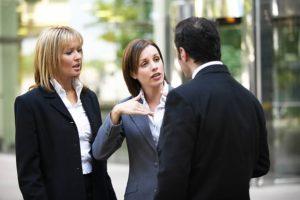 two women talking to a man