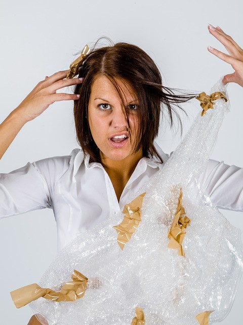 woman tangled in packing tape