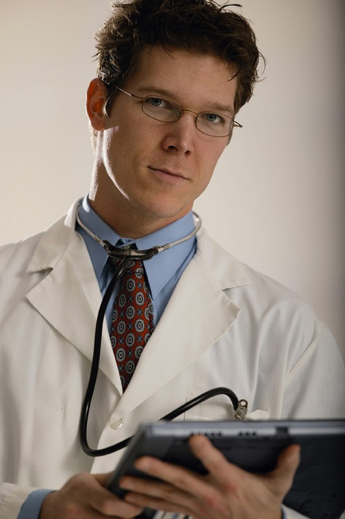 image of physician holding a computer
